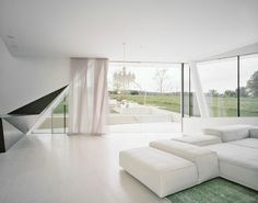 White Interior as Living Room Decorated Among White Sofa Furniture under Modern Design as Home Inspiration To Your House