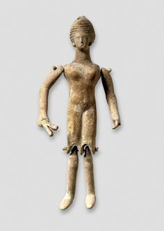 Terracotta dancing doll holding castanets.  Corinthian. c. 350 BC  (British Museum)
