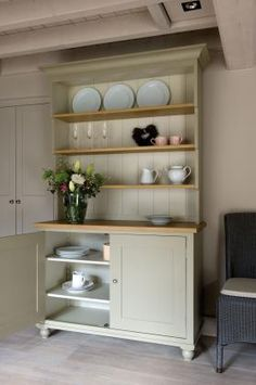 The Suffolk range has its design roots in the Shaker movement. Items needed to be practical, fit for purpose but without embellishments. Yet quality was expected to be of an exacting and high standard. Consequently the Suffolk range is beautiful in its simplicity and revels in its quality. The Neptune Suffolk 4ft Open Rack Dresser has three oak shelves arranged using a rare step out feature. It is painted in two tones; Honed Slate for the exterior surfaces and Old Chalk for the interior.