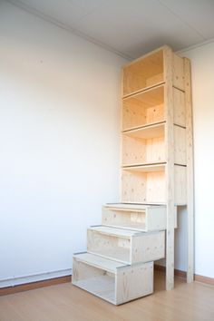 The bottom shelves slide out to make steps for the books on top.