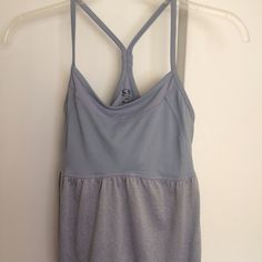 Champion workout top Built in bra, no pads. Has drawstring waist. Re-poshing, in excellent condition, evidently I just don't like drawstring waist!   trades.  Champion Tops Tank Tops