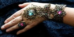 Steampunk slave bracelet inspired by Victorian times. Filigree and rhinestones by Cyanida.