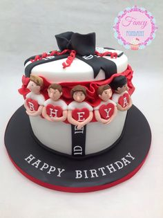 A One Direction cake made by Fancy Fondant x