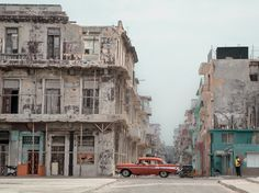 A snapshot of Havana, Cuba, features dilapidated buildings and a classic car in this National Geographic Photo of the Day.