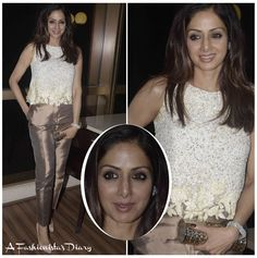 Sridevi looked chic and classy while attending an event last night in Mumbai.  She wore an embellished top and organza trousers by Manish Malhotra.  Loved this look which she finished off with a Jimmy Choo clutch.