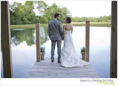 Bride and groom at the end of a dock.