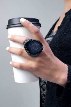black statement ring with white nail polish