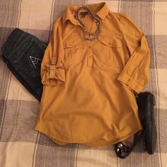 ANTHROPOLOGIE FEI SIMPLE COSMOPOLITAN BLOUSE Super cute and brand new. Can use as a long sleeve or half sleeve, with jeans or as a social shirt....it looks good in any way! The color is Mustard Fei Tops Blouses