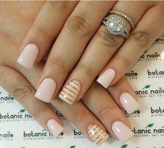 Light pink, gold stripes, gel acrylic nails