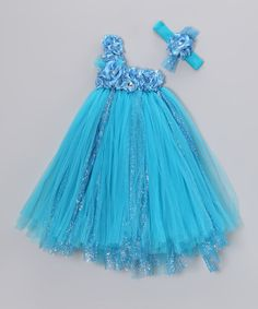 Perfect for little twirlers, this vibrantly hued frock touts two layers of tulle and matching lining, so it's always soft, never itchy. A stretchy bodice keeps it securely in place, while silky flowers, cascades of glitter and a matching headband finish off this fluffy waterfall of fabulousness! Includes dress and headband   Headband: 14'' circumference