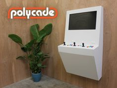 Polycade - the wall-mounted arcade machine originating on Kickstarted. This cabinet is the child of Tyler Bushnell, Dylan Bushnell and Charles Carden.