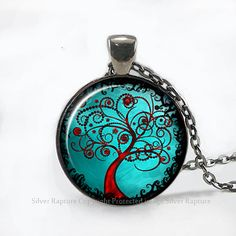 "Keep the peace wherever you go with this glass pendant ""Tree of Life"" necklace by Silver Rapture. Featuring beautiful artwork sealed under glass, this handmade pendant also comes with an antique silver metal bezel tray, delicate 22-inch silver-plated chain and a gift bag tied with a ribbon ready to give."