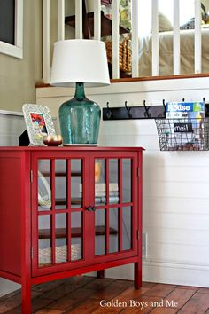Affordable entryway makeover using Target Threshold Windham red cabinet-www.goldenboysandme.com