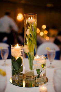 Submerged Flower Centerpieces with Floating Candles | Photo: Sarah Bradshaw Photography | Florals: Flowers By Bella
