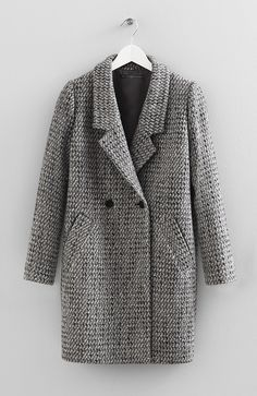 $350 Wool tweed boyfriend coat with two front pockets and button front details. 87 cm long. Made in Canada.