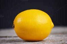 fresh lemons on the black background by Victoria Rusyn Shop on Creative Market