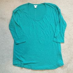 J Crew 3/4 sleeve tshirt NWOT 3/4 sleeve teal t shirt.  This shirt has a generous cut and could fit a medium as well as a small.  Cute seam down the back.  No trades. J. Crew Tops