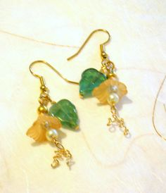 """These lucite flower dangle earrings are perfect for Spring.  I loved making the gold art wire """"tendrils"""".  So feminine and pretty!"""