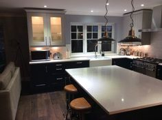 Wren Kitchens: Linda Barker Shaker Kitchen in Baltic and Pebble Matt with granite worktops. Makes for a sophisticated kitchen/living space!