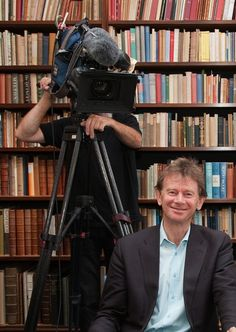 Sometimes we're on telly: Michael Wood filming in the Keynes Room at Cambridge University Library