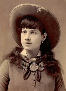 """Annie Oakley (August 13, 1860 – November 3, 1926), born Phoebe Ann Moses,[1][2][3] was an American sharpshooter and exhibition shooter. Oakley's ""amazing talent""[4] led to a starring role in Buffalo Bill's Wild West show. Her timely rise to fame[5] allowed her to become one of the first American women to be a superstar."" Wikipedia"