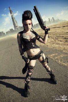 <3 Badass and fucking hot!!! moehawk, gun, gun holster, garter belt, steampunk, post apocalyptic, gloves, tattoos, makeup