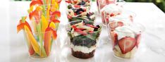 Single-Portion Snacks for Parties - Layered party food looks beautiful and impressive... that is, until the first party guest inserts the big serving spoon and makes a muddy mess of it. Keep your servings looking great the entire time by making individual portions! Each one stays pretty and palatable — even for those coming back for seconds (or thirds). Also, individual portions in cups means no more balancing a large plate while trying to talk.