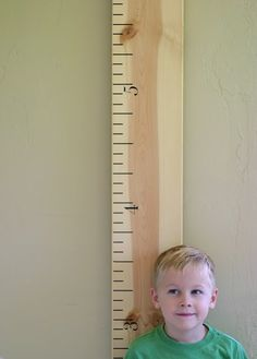 DIY: Oversize Growth Chart Ruler --- Where to buy the number decals: http://www.etsy.com/listing/62356748/ruler-growth-chart-vinyl-decal ---  Instructions on How To Make The Board: http://www.abbieshouse.com/2012/04/instructions-for-applying-ruler-growth.html