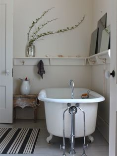 Beautiful Vintage Bathroom Decor Ideas - Many individuals don't generally come to consider decorating their bathrooms contrasted with any piece of the house. What individuals dependably have . Diy Bathroom, Bathroom Shelves, Master Bathroom, Bathroom Ideas, White Bathroom, Bathroom Vintage, Vintage Tub, Bathroom Interior, Remodel Bathroom