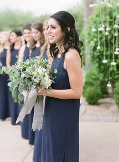 Photography: Elyse Hall Photography - http://www.stylemepretty.com/portfolio/elyse-hall-photography Bridesmaids' Dresses: Natalie Deayala Collection - http://www.stylemepretty.com/portfolio/natalie-deayala-collection Floral Design: Butterfly Petals - http://www.stylemepretty.com/portfolio/butterfly-petals   Read More on SMP: http://www.stylemepretty.com/2015/08/24/blogger-bride-a-dash-of-details-rustic-elegant-spring-wedding/
