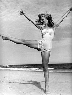 Marilyn Monroe dances on the beach.