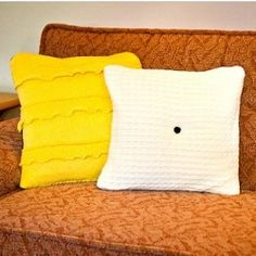Make decorative throw pillows out of your old, favorite sweaters for a cozy look and feel! Tutorial from Curbly