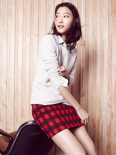 madewell gamine mini skirt worn with the feature pullover sweater + flannel sunday shirt.