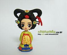 Cute kawaii asian character figurine, looks like polymer clay