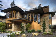 Modern Style House Plan - 4 Beds 4.5 Baths 4750 Sq/Ft Plan #132-221 Exterior - Front Elevation - Houseplans.com