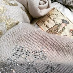 Gold and swarovski details on pure softly cashmere..