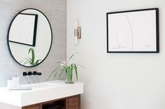 Modern Floating Bathroom Vanity Design: Andria Fromm Photo: Ruby and Peach #modernbathroom #modernlighting #modernmasterbath #moderntile #bathroomtile #modernflooring #bathroomvanity #floatingvanity #bathroommirror #wallmountfaucet #modernbathroomhardware #matteblackhardware #matteblackfaucet #freestandingtub #whitetub #modernbathtub #bathtub #bathroomstorage #bathroomcountertops #roundmirror #moderndecor #bathroomlighting #bathroomart #bathroomsconce #sconce