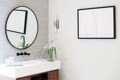 Modern Floating Bathroom Vanity Design: Andria Fromm Photo: Ruby and Peach #modernbathroom #modernlighting #modernmasterbath #moderntile #bathroomtile #modernflooring #bathroomvanity #floatingvanity #bathroommirror #wallmountfaucet #modernbathroomhardware #matteblackhardware #matteblackfaucet #freestandingtub #whitetub #modernbathtub #bathtub #bathroomstorage #bathroomcountertops #roundmirror #moderndecor #bathroomlighting #bathroomart #bathroomsconce #sconce
