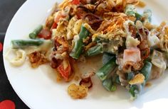 Gourmet Green Bean Casserole takes the classic to a new level with red bell peppers, Parmesan cheese and toasted shallots. Creamy and crunchy deliciousness.