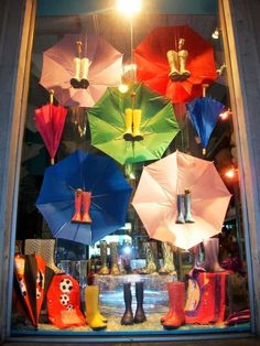 13 Rainbow Themed Decorations For Your Magical Home - HomelySmart - HomelySmart Boutique Window Displays, Window Display Retail, Christmas Window Display, Retail Windows, Shop Windows, Spring Window Display, Display Windows, Window Display Design, Shoe Display