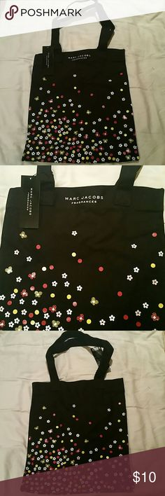 "Marc Jacobs fragrances canvas tote bag NWT Marc Jacobs fragrances canvas tote bag. Design after Dot and Daisy fragrances. 15.5"" height, 13"" width. Never been used.  Super cute for books, farmers market, beach, anything! Marc Jacobs Bags Totes"