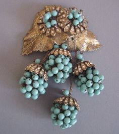 Miriam Haskell vintage pin with 'berry' drops.