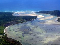 iSimangaliso Wetland Park, South Africa - The park features a variety of landforms, including coral reefs, long sandy beaches, coastal dunes, lake systems, and papyrus wetland, caused by fluvial, marine and aeolian processes.