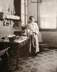 Late Victorian-era lady in her kitchen