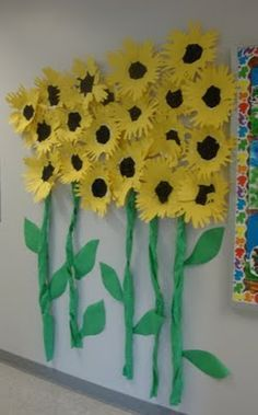 What a great children's project. The kids traced their hands (about 8 of them on yellow construction paper) and cut them out for the petals. Crumpled tissue paper for the center and it's all glued onto a paper plate. Love it!