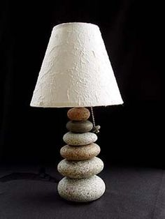 Named for the cairn rock trail markers used on our Maine hiking trails. Carefully selected beachstones are stacked, scribed and ground so they fit Rock Lamp, Twig Furniture, Garden Furniture, Stone Lamp, Rustic Art, Rustic Lamps, Driftwood Crafts, Concrete Lamp, Candle Lamp
