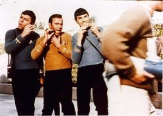 DeForest Kelley, William Shatner and Leonard Nimoy pretending to shave with their phasers on the Star Trek set, 1968