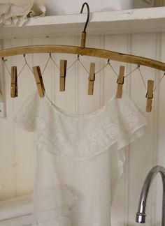 Vintage hanger just add hooks, twine and clothespins...
