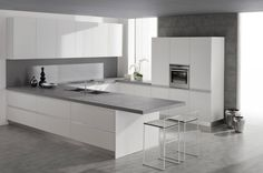 Minimalist Italian Kitchen Design with the Modern Idea:White Clean Kitchen Island With Grey Solid Surface Countertop And Slim Bar Stools Above Ceramic Flooring