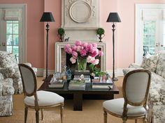 The walls of this living room received a cheery coat of Fruit Shake by Benjamin Moore. The trim is done in White Dove.